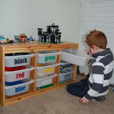 I'm totally doing this in my kids toy room !! Each tote will have a set name (like Ninjago or Star Wars) instead of colors.