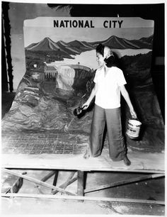 Image of a woman setting up an exhibit of National City at the San Diego County Fair, 1939.