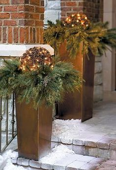 Flank your entry with an elegant lighted display with the Pre-lit Pinecone Christmas Greenery Collection that features an abundant mixture of lifelike greenery embellished with natural elements and soft glowing lights.