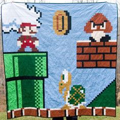 I've joined the ranks of nerdy quilters. One Mega Man quilt down... what to do next??