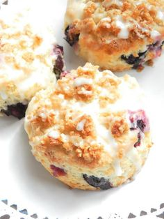 Blueberry Lemon Scones made with buttermilk, topped with an oatmeal streusel and lemon glaze.