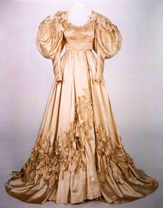 "Vivien Leigh's wedding dress as Scarlett O'Hara from ""Gone with the Wind."" This dress is featured in the scene when she marries Charles Hamilton."