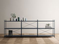 Punctual is a high quality shelving system from Ferm Living with powder coated metal elements soft colours. Features is combination 3x3.  http://www.nest.co.uk/product/ferm-living-punctual-shelving-system-3x3