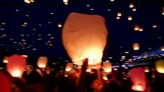 This video shows the traditional Thai sky lanterns being released at the Yi Peng Festival. Historically, the lanterns symbolize a release of your past problems and worries, allowing you to start anew.