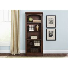 Create scale, add comfort, and define your style with Brayton Manor Home Office. A classic desk and credenza/hutch combo can satisfy your work habits as well as reflect your style. Combines a cognac finish with antique brass bail and knob hardware.
