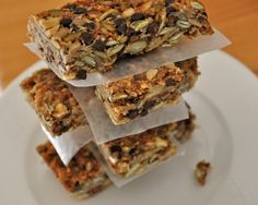 granola bar recipe from Real Healthy - loaded with the good stuff! ~semi-SUCCESS: delicious flavor, but didn't hold together: became granola. Also, coconut oil and flax burned - use another pan-greaser and watch the time carefully Healthy Granola Bars, Homemade Granola Bars, Healthy Bars, Healthy Treats, Vegan Granola, Yummy Treats, Snack Recipes, Healthy Recipes, Primal Recipes