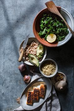quick & easy vegan kale, white bean, and charred tempeh salad with avocado, quinoa, dukkah, and a lemony vinaigrette! This detox salad is dairy free, gluten free, healthy, and vegan, and it can be adapted to the keto, paleo, and whole 30 diets by omitting the quinoa and beans! You can even simmer it in stock to turn it into a soup!