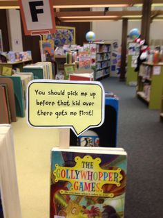 School library shelf talkers. So cute! I'm going to use this idea in my library
