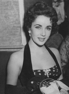 "jeannecrains: ""Elizabeth Taylor attends the premiere of The Lady with the Lamp in Leicester Square, London, September 1951 """