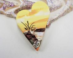 Rustic Handmade Polymer Clay 34mm Cabochon Pendant Focal Bead-Sedona Sunset-Southwestern Orange Pink Purple Bead-PA100281  Collection: Escape........................... Series: Sedona Sunset Lovely views of the setting sun in Red Rock country. Each scape is created by a special method of layering and blending multiple polymer clay colors. This technique results in a beautiful abstract composition of sky, mountains, and earth. Enjoy!  Specifications: Listing is for one cabochon/pendant Th...