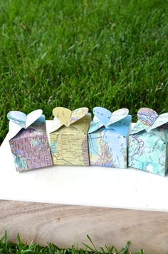 MAP / TRAVEL THEMED WEDDING IDEAS on EmmalineBride.com - map favor boxes by thepathlesstraveled