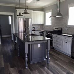 Gourmet kitchen fully stocked to cook for a crowd!  Granite, stainless steel, ice maker, microwave drawer, oversized refrigerator and much much more!  #vacation #oceanisle #anyportinastorm