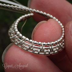 https://flic.kr/p/DTVZfH | Sitting here waiting for my daughter's school bus and playing with sterling silver bead wire.