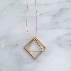 | ORPHAN SOCKS | brass geo necklace