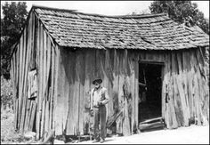 Former slave, George Carson, standing by the house in which he lived after coming to Florida in 1875. George Carson: Jefferson County, Florida (1937)