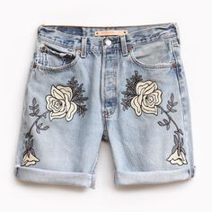 """Combining elements of vintage Hollywood western wear with a modern color  palette and design, The Shadows of Mountains Denim Short features chain  stitch embroidery in grey, charcoal, and black on an authentic pair of  vintage Levis.  This item is Made to Orderin approx. 4 weeks from purchase date.  CONTENT+ CARE - Cotton - Dry Clean - Made in the USA  SIZE + FIT - 9"""" Inseam folded to 4"""" - Lower rise fit that is loose through the hip and bum. - For a higher waist fit, that is slimmer…"""