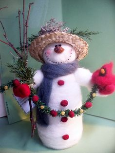 This 9 tall wool wrapped and needlefelted Snowman stands tall with pine garland of tansy and cranberries. Her straw hat sports a moss birdnest. She holds a wool felted cardinal in her hand. This snowman stands taller than the other snowmen listed. Christmas Hearts, Felt Christmas, Christmas Snowman, Christmas Ornaments, Xmas, Felt Snowman, Snowman Crafts, Felt Crafts, Wool Felt