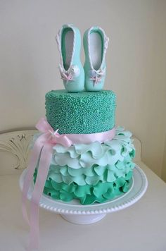 All fondant and sugar pearls. Ballerina cake. Tiered cake. Green cake.