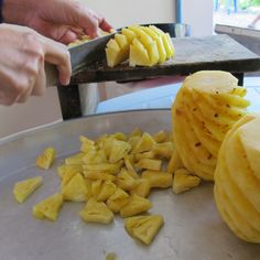 Cutting a half of Pineapple into wedges