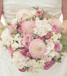Another sweet round bouquet of pink hydranges, pink spray roses, white bouvardias and pink dahlias.