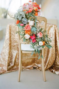 Chair adorned with beautiful blooms and greenery