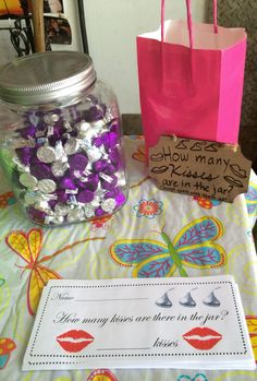 Bridal Shower Game: How many kisses? Each guest guesses how many Hersey's kisses are in the jar! The one with the closest answer wins all the kisses! I waited for an after Easter candy sale to buy all the candy & the cute sign is from the Target Dollar Section!