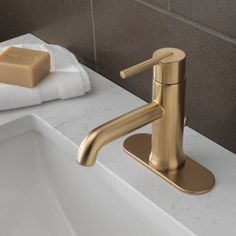 $213 bronze Charming and simplistic, the Delta Trinsic Single Handle Single Hole Bathroom Faucet is a brilliant accessory for your bathroom. The faucet's solid brass fabricated body ensures years of reliable use and provides industrial strength. It is available in multiple finishes and is perfect for bathrooms with contemporary settings. The faucet has a single handle and a single hole sink configuration. It includes a metal push pop-up drain. The flow rate of the faucet is 1.5 gallons per…