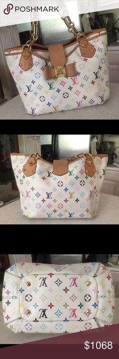 Authentic Annie Louis Vuitton White Murakami Tote Date Code SR2170 Made in France 27weeks of 2010. Smells like leather. Exterior in okay condition has slight dirt and ink marks stains on the ribbon from normal use but unnoticeable. Logos fading from rubbings but no peeling or holes on the bottom sides. Unique closure is twistable square knobs in excellent condition. The Gold Hardware are sturdy attached on the leather gold chains for shoulder straps. Annie purse is one the kinds Louis…