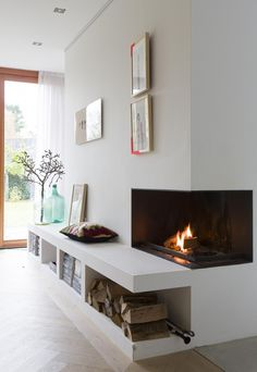 Are you looking for some amazing ideas for your new corner fireplace? Explore the top best corner fireplace designs featuring luxury angled interior ideas and inspiration. Fireplace Built Ins, Home Fireplace, Living Room With Fireplace, Fireplace Design, Home Living Room, Living Room Designs, Living Spaces, Fireplace Ideas, Fireplace Modern