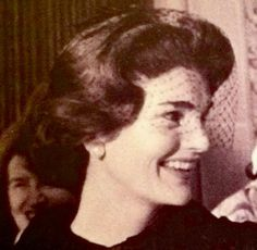 A very happy Jackie at St. Patrick's Cathedral in New York City at Caroline's christening on December 13, 1957.