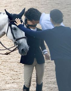 Smooching: Mary-Kate Olsen received a kiss from husband Olivier Sarkozy before she competed in the Hamptons Classic Horse Show in New York on Thursday