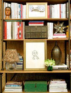 Shelf with books, frames, lamp, vase