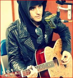 Jared Leto playing the guitar