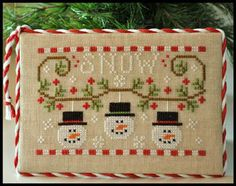Country Cottage Needleworks Snowmen Trio - Cross Stitch Pattern. Model stitched on 28 ct Lambswool linen using DMC floss. Stitch count 75x48.