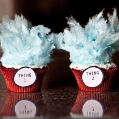 Red velvet 'Thing 1, Thing 2' cupcakes with blue cotton candy hair.
