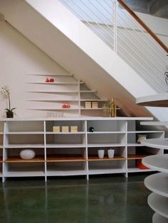 Decorating, under stair storage ideas. To maximize space in your home, utilizing under stairs storage space solutions can help to de-clutter and create functionality in an otherwise unused space. Stair Shelves, Staircase Storage, Hallway Storage, Stair Storage, Staircase Design, Coat Storage, Extra Storage, Craft Storage Ideas For Small Spaces, Space Under Stairs