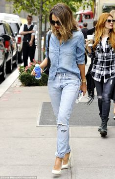 On the go: The 33-year-old looked casually chic in a denim top and a faded pair of skinny jeans