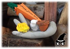 """This concrete Hand was """"dressed"""" to function as Easter Table Decoration gifts and favours. It'll hold a medium sized pot and is suitable to be placed outdoors."""