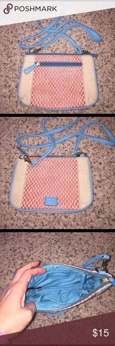 Fossil cross body purse Excellent used condition. Fabric Fossil cross body purse. Carried only a few times. Strap can be removed. Tiny flaw shown in last photo. Perfect bag for summer trips! Fossil Bags Crossbody Bags