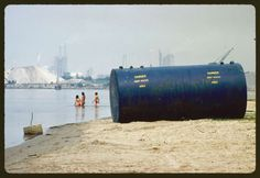 Original caption:Chemical plants on shore are considered prime source of pollution. Marc St. Gil, Lake Charles, Louisiana.  Date:June, 1972. Photo: NARA