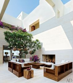 """It probably won't come as a surprise that this stunning courtyard terrace belongs to a celebrity couple. Cindy Crawford and Rande Gerber own this grand villa located on the southern tip of Mexico's Baja peninsula. The terrace features a frangipani tree, teak furnishings with accent pillows from [John Robshaw](http://www.johnrobshaw.com//?utm_campaign=supplier/