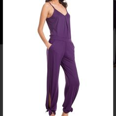 Trina Turk purple jumper NWT. Oh so comfortable! This purple jumper has a slit in the leg that you can tie it for a different look or just leave it flowing.  Size Petite. Trina Turk Pants Jumpsuits & Rompers