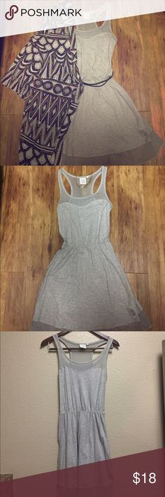 Grey racerback Rip Curl dress Adorable Rip Curl dress with mesh panels on back and front. Only worn a few times-has no visible signs of wear. Very soft t-shirt material. Can be dressed up or worn casually to the beach. Size small. Rip Curl Dresses Midi