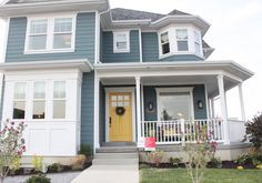 love the look of this home, yellow door, grey/blue, white woodwork