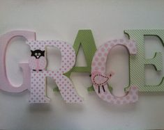 I could make this.. buy some wood letters at the craft store, get scrapbook paper, mod-podge, voila.