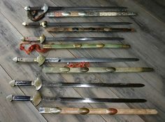 A beautiful collection of old jian swords http://www.chinese-swords-guide.com/antique-swords.html
