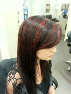 Black hair with red highlights. Definitely doing this again in the fall