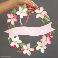 You'll find all the tools, materials, and steps to make this cute Mother's Day wreath here. Trust us - it's easier than you think!
