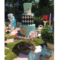 What an incredible cake at an Alice in Wonderland birthday party! See more party ideas at CatchMyParty.com!