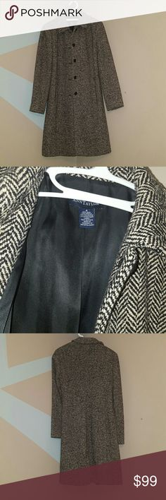 Ann Taylor Chevron Peacoat Shell 46% wool, 29% acrylic, 23% polyester, 2% other fiber. Lining 100% acetate.  Black and off white chevron pattern  5 buttons and two front pockets  Worn several seasons. Some pilling throughout but in good condition! Ann Taylor Jackets & Coats Pea Coats